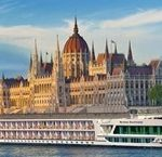 A cruise ship on a river in Europe.